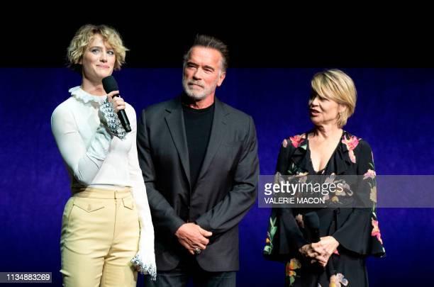 Actors Mackenzie Davis Arnold Schwarzenegger and Linda Hamilton speak on stage during the CinemaCon Paramount Pictures Exclusive Presentation at the...