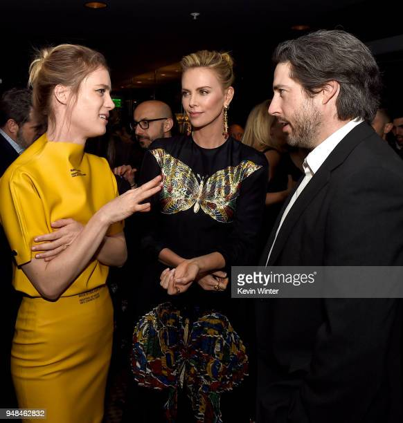 Actors Mackenzie Davis Charlize Theron and director Jason Reitman pose at the after party for the premiere of Focus Features' 'Tully' at WP24 on...