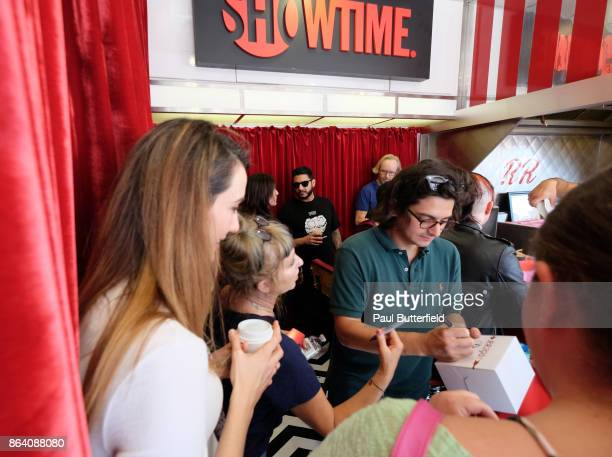 Actors Madeline Zima Kimmy Robertson and Josh Fadem sign merchandise at Showtime's 'Twin Peaks' Double R Diner PopUp on Melrose Avenue on October 20...