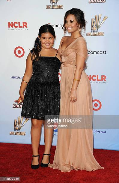 Actors Madison De La Garza and Demi Lovato arrives at the 2011 NCLR ALMA Awards held at Santa Monica Civic Auditorium on September 10 2011 in Santa...