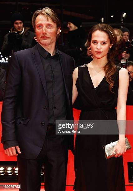 Actors Mads Mikkelsen and Alicia Vikander attend the En Kongelig Affaere Premiere during day eight of the 62nd Berlin International Film Festival at...