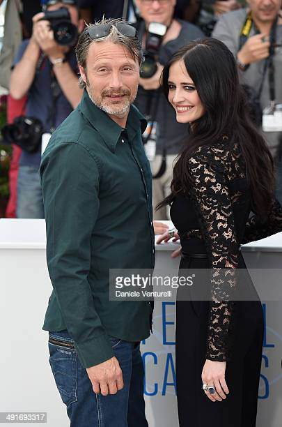 Actors Mads Mikkelsen and Eva Green attend 'The Salvation photocall at the 67th Annual Cannes Film Festival on May 17 2014 in Cannes France