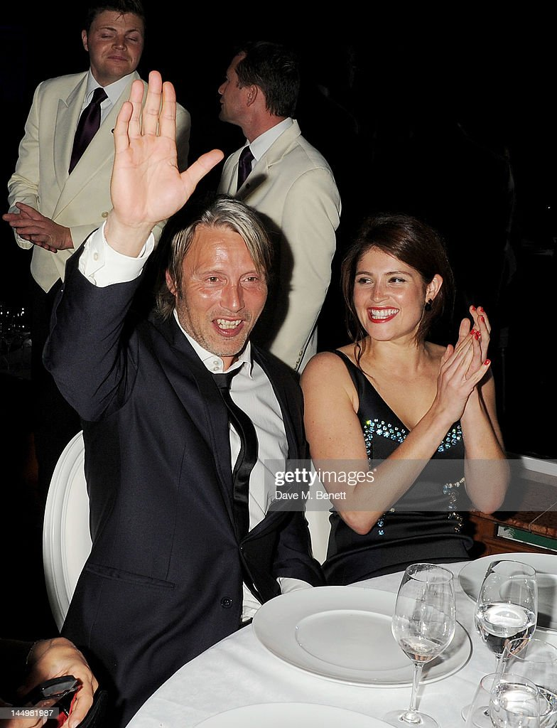 Actors Mads Mikkelsen (L) and Gemma Arterton attend the IWC and Finch's Quarterly Review Annual Filmmakers Dinner at Hotel Du Cap-Eden Roc on May 21, 2012 in Antibes, France.
