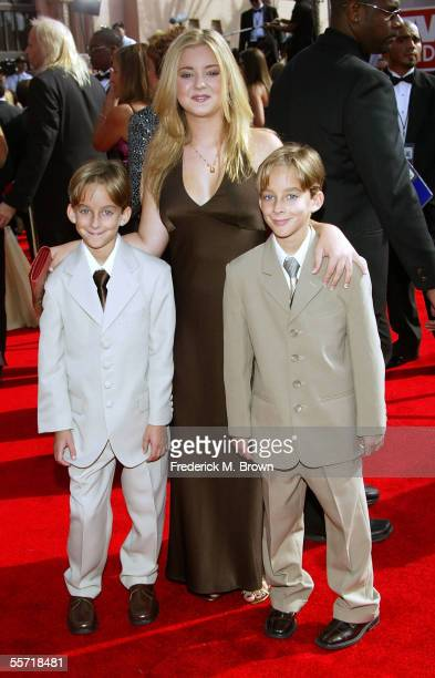 Actors Madylin Sweeten and brothers Sawyer Sweeten and Sullivan Sweeten arrive at the 57th Annual Emmy Awards held at the Shrine Auditorium on...