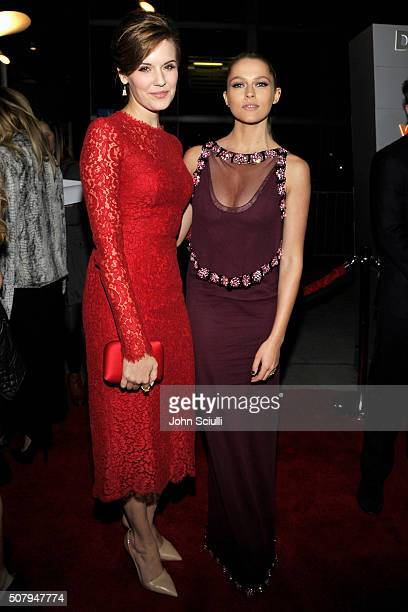 Actors Maggie Grace and Teresa Palmer attend the premiere of Lionsgate's 'The Choice' at ArcLight Cinemas on February 1 2016 in Hollywood California