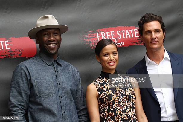 Actors Mahershala Ali Gugu MbathaRaw and Matthew McConaughey attend the photo call for STX Entertainment's Free State Of Jones held at the Four...
