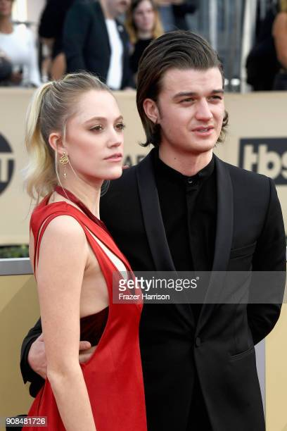 Actors Maika Monroe and Joe Keery attend the 24th Annual Screen ActorsGuild Awards at The Shrine Auditorium on January 21 2018 in Los Angeles...