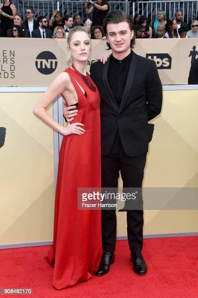 Actors Maika Monroe and Joe Keery attend the 24th Annual Screen Actors Guild Awards at The Shrine Auditorium on January 21 2018 in Los Angeles...