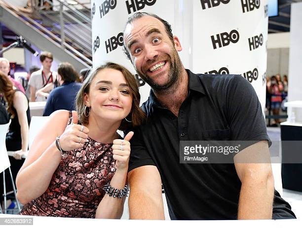 Actors Maisie Williams and Rory McCann attend HBO's 'Game of Thrones' cast autograph signing during ComicCon 2014 on July 25 2014 in San Diego...