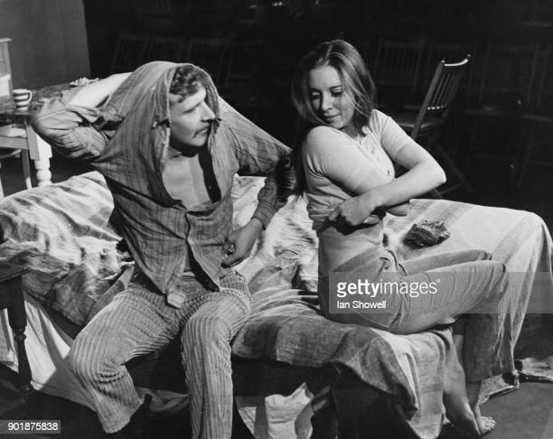 Actors Malcolm Tierney and Domini Blythe in a bedroom scene from the play 'Come and Be Killed' during dress rehearsals at the Open Space Theatre in...