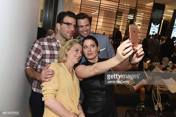 Actors Mamie Gummer Zachary Quinto Andrew Rannells and Debra Messing take a selfie as Cadillac celebrates the grand opening of 'Cadillac House' on...
