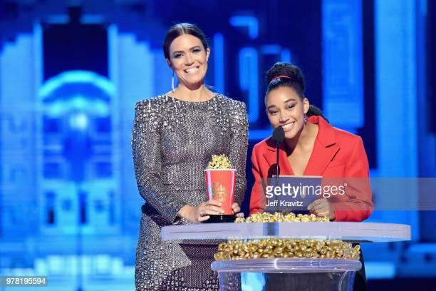 Actors Mandy Moore and Amandla Stenberg attend the 2018 MTV Movie And TV Awards at Barker Hangar on June 16 2018 in Santa Monica California