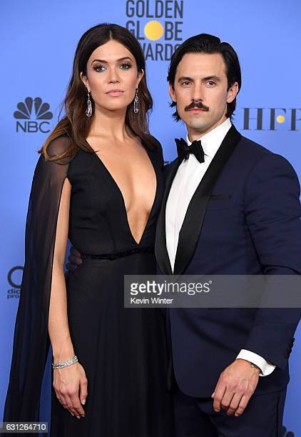 Actors Mandy Moore and Milo Ventimiglia pose in the press room during the 74th Annual Golden Globe Awards at The Beverly Hilton Hotel on January 8...