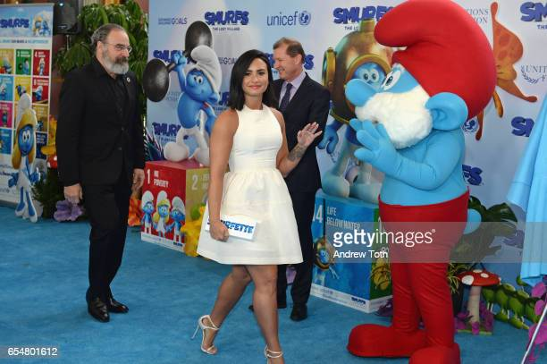 Actors Mandy Patinkin and Demi Lovato at the United Nations Headquarters celebrating International Day of Happiness in conjunction with SMURFS THE...