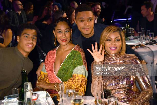 Actors Marcus Scribner Tracee Ellis Ross TV personality Trevor Noah and Taraji P Henson attend the 2017 MTV Movie And TV Awards at The Shrine...