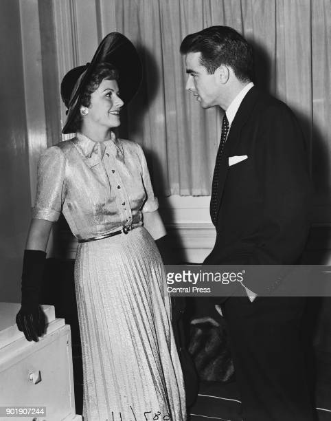 Actors Margaret Lockwood and Montgomery Clift chatting at a reception at Londonderry House Park Lane London for the stars of the upcoming Royal Film...