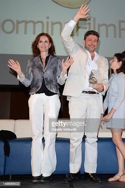 Actors Margaret Mazzantini and Sergio Castellitto attend the 'Premio Cariddi Alla Famiglia Castellitto' during the 58th Taormina Film Fest on June...