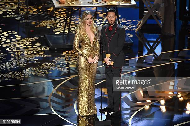 Actors Margot Robbie and Jared Leto speak onstage during the 88th Annual Academy Awards at the Dolby Theatre on February 28 2016 in Hollywood...