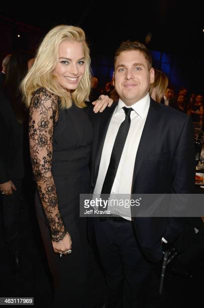 Actors Margot Robbie and Jonah Hill attend the 19th Annual Critics' Choice Movie Awards at Barker Hangar on January 16 2014 in Santa Monica California
