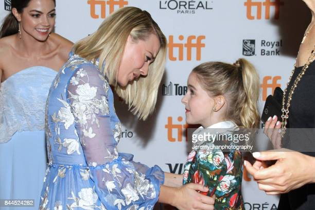 Actors Margot Robbie and McKenna Grace share a moment during the I Tonya Premiere during the 2017 Toronto International Film Festival held at...