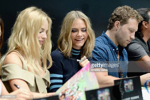 Actors Margot Robbie Cara Delevigne and Jai Courtney from the cast of Suicide Squad film participates in an autograph session for fans in DC's 2016...