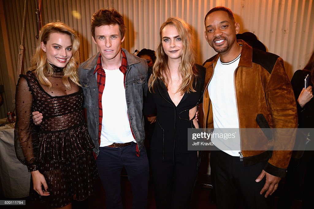 Actors Margot Robbie, Eddie Redmayne, model Cara Delevingne and actor Will Smith attend the 2016 MTV Movie Awards at Warner Bros. Studios on April 9, 2016 in Burbank, California. MTV Movie Awards airs April 10, 2016 at 8pm ET/PT.