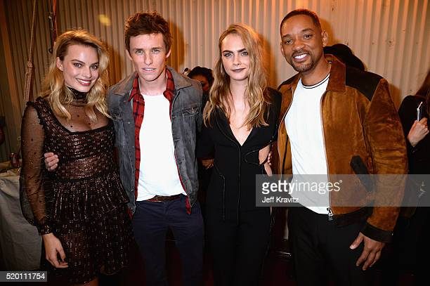 Actors Margot Robbie Eddie Redmayne model Cara Delevingne and actor Will Smith attend the 2016 MTV Movie Awards at Warner Bros Studios on April 9...