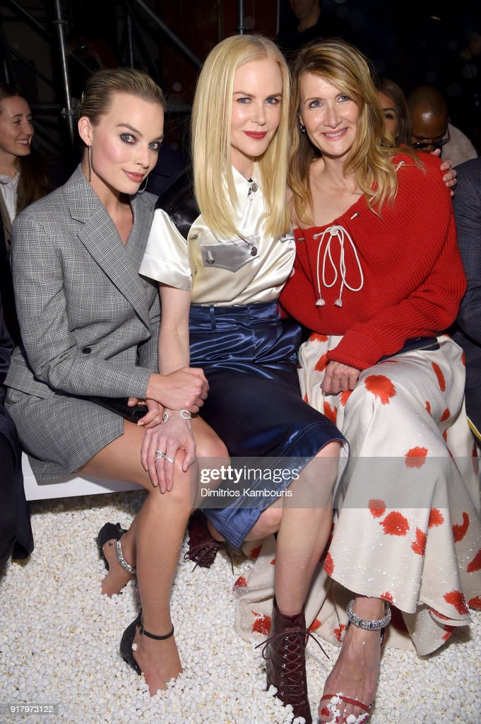 Actors Margot Robbie, Nicole Kidman, and Laura Dern attend the Calvin Klein Collection front row during New York Fashion Week at New York Stock Exchange on February 13, 2018 in New York City.