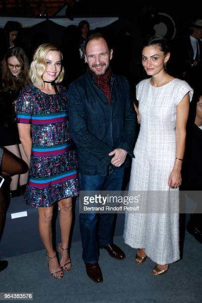 Actors Margot Robbie Ralph Fiennes and Phoebe Tonkin attend the Chanel Cruise 2018/2019 Collection Front Row at Le Grand Palais on May 3 2018 in...