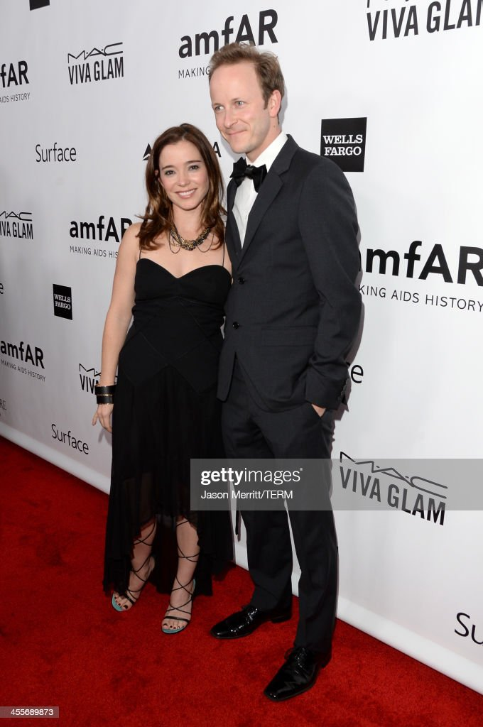 Actors Marguerite Moreau and Christopher Redman attend the 2013 amfAR Inspiration Gala Los Angeles at Milk Studios on December 12, 2013 in Los Angeles, California.