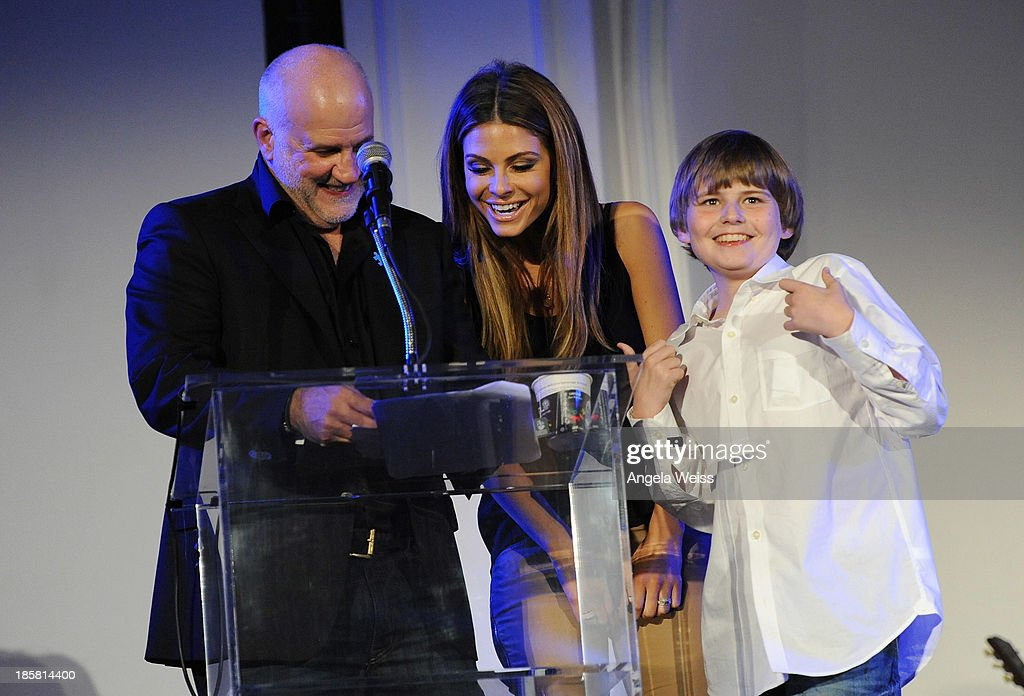 Actors Maria Menounos (C), Michael Chiklis and his son Jackson attend Autism Speaks' 3rd Annual 'Blue Jean Ball' presented by The GUESS Foundation at Boulevard 3 on October 24, 2013 in Hollywood, California.