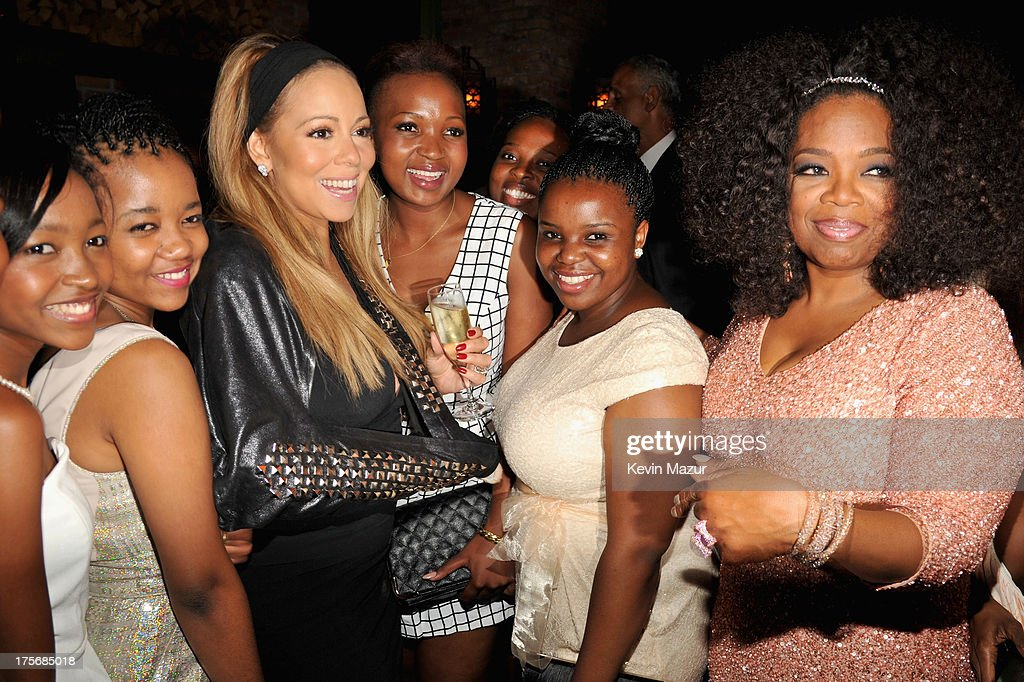 Actors Mariah Carey and Oprah Winfrey pose with guests at Lee Daniels' 'The Butler' New York premiere, hosted by TWC, DeLeon Tequila and Samsung Galaxy on August 5, 2013 in New York City.