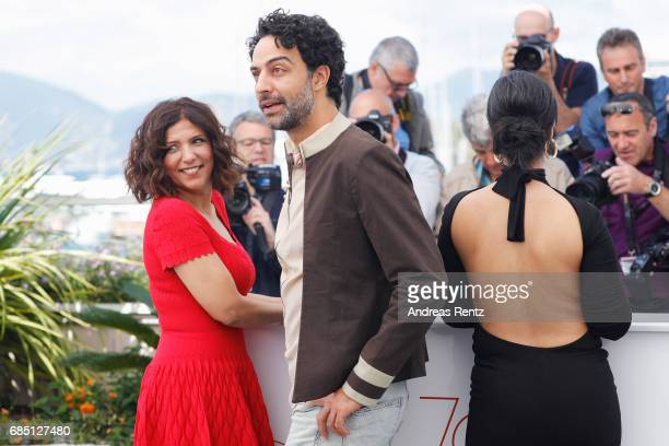 Actors Mariam Al Ferjani Ghanem Zrelli and director Kaouther Ben Hania attend Alaka Kaf Ifrit Photocall during the 70th annual Cannes Film Festival...