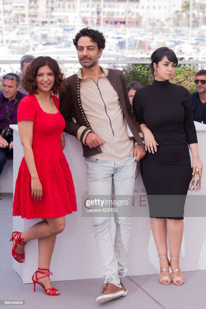 Actors Mariam Al Ferjani, Ghanem Zrelli and director Kaouther Ben Hania attend 'Alaka Kaf Ifrit (La Belle Et La Meute)' Photocall during the 70th annual Cannes Film Festival at Palais des Festivals on May 19, 2017 in Cannes, France.
