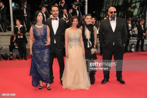 Actors Mariam Al Ferjani Ghanem Zrelli director Kaouther Ben Hania actors Anissa Daoud and Chedly Arfaoui from the movie 'Alaka Kaf Ifrit ' attend...