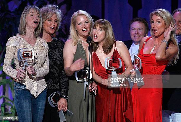 Actors Marianne Gordon Rogers, Gunilla Hutton, Misty Rowe, Barbi Benton, Roy Clark and Linda Thompson accept the Entertainers Award onstage during...