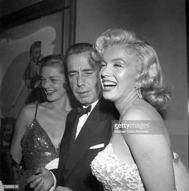 Actors Marilyn Monroe and Humphrey Bogart and Lauren Bacall attend the premiere of her movie 'How To Marry A Millionaire' on November 4 1953 in Los...