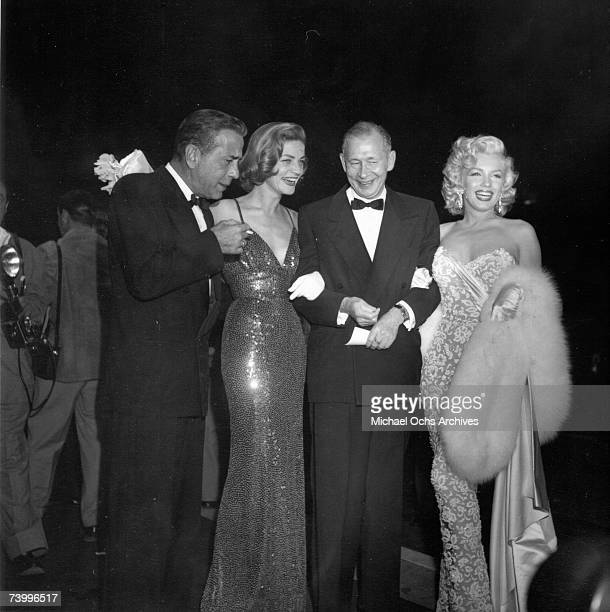 Actors Marilyn Monroe Lauren Bacall and Humphrey Bogart attends the premiere of the movie 'How To Marry A Millionaire' with a guest on November 4...