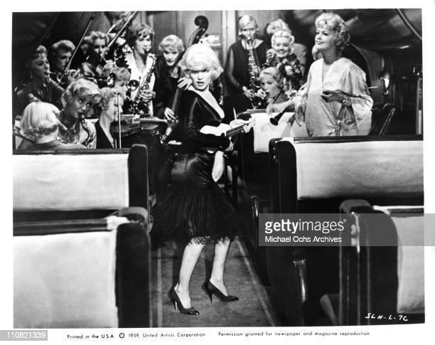 Actors Marilyn Monroe Tony Curtis and Jack Lemmon with bandleader Joan Shawlee in a scene from the United Artists movie 'Some Like It Hot' in 1959 in...