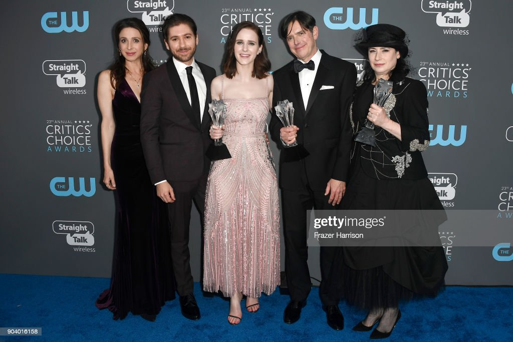 Actors Marin Hinkle, Michael Zegen, Rachel Brosnahan, fillmmakers Dan Palladino and Amy Sherman-Palladino, recipients of the Best Comedy Series award for 'The Marvelous Mrs. Maisel', pose in the press room during The 23rd Annual Critics' Choice Awards at Barker Hangar on January 11, 2018 in Santa Monica, California.