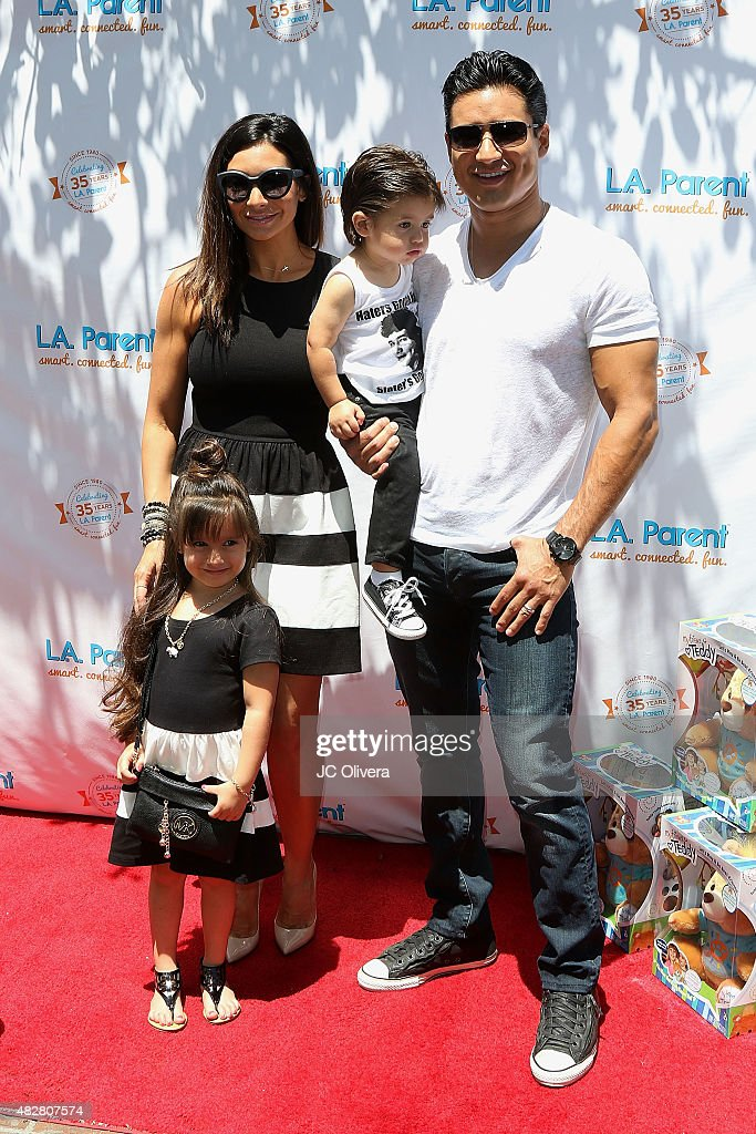Actors Mario Lopez (R), Courtney Mazza and their children Gia Lopez and Dominic Lopez attend L.A. Parent's 35th birthday bash at Original Farmers Market on August 2, 2015 in Los Angeles, California.
