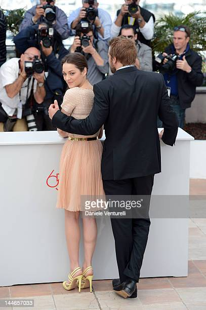 "Actors Marion Cotillard and Matthias Schoenaerts attend the ""De Rouille et D'os"" Photocall during the 65th Annual Cannes Film Festival at Palais des..."