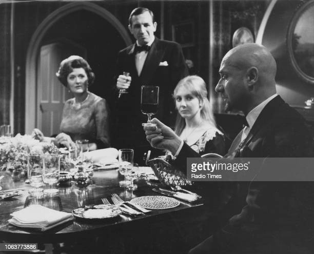 Actors Marion Mathie Leonard Rossiter Maureen O'Brien and Donald Pleasence in a dinner table scene from the episode 'Taste' of the television series...