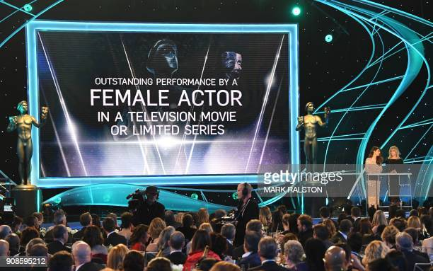 Actors Marisa Tomei and Rosanna Arquette speak onstage during the 24th Annual Screen Actors Guild Awards show at The Shrine Auditorium on January 21...