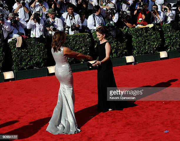 Actors Mariska Hargitay and Tina Fey arrive at the 61st Primetime Emmy Awards held at the Nokia Theatre on September 20 2009 in Los Angeles California