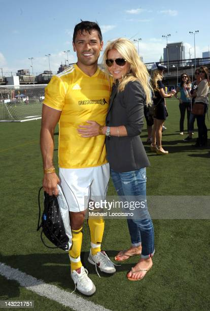 Actors Mark Consuelos and Kelly Ripa attend the Tribeca/NYFEST Soccer Day Celebrity Match during the 2012 Tribeca Film Festival at the Pier 40 on...