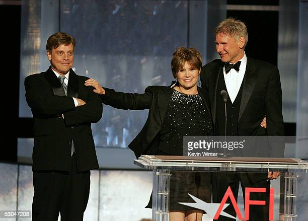 Actors Mark Hamill Carrie Fisher and Harrison Ford speak onstage during the 33rd AFI Life Achievement Award tribute to George Lucas at the Kodak...