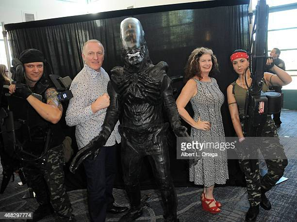 Actors Mark Rolston and Jenette Goldstein pose with their characters from Aliens at the 2015 Monsterpalooza Horror Convention held at the Marriott...