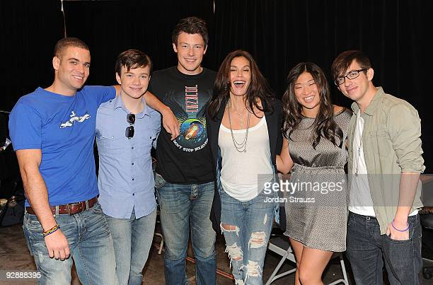 Actors Mark Salling Chris Colfer Cory Monteith Teri Hatcher Jenna Ushkowitz and Kevin McHale pose backstage as the cast of Glee signs copies of Glee...