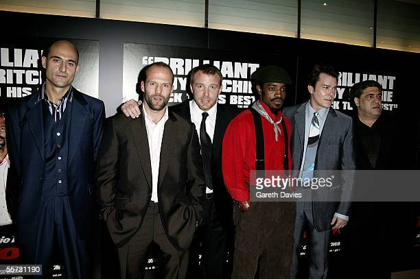 """Actors Mark Strong, Jason Statham, director Guy Ritchie, actors Andre """"Andre 3000"""" Benjamin, Ray Liotta and Vincent Pastore pose at the UK premiere..."""